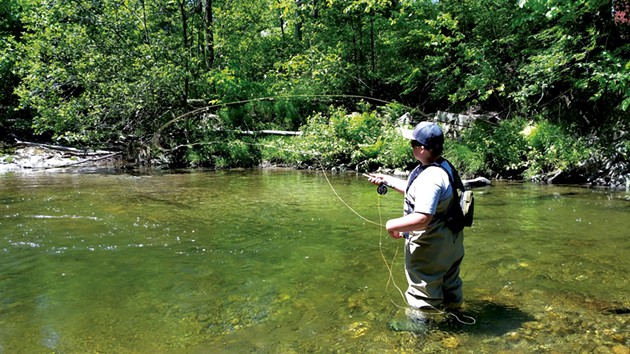 Zach Favreau fishing in the Brewster River - SARAH YAHM
