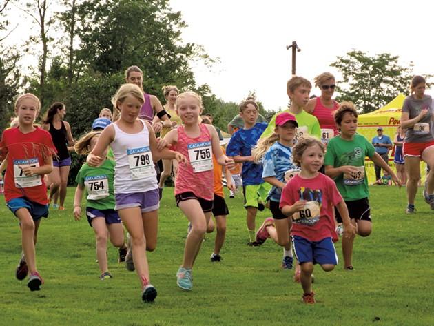 Kids take off at the start of Catamount's Tuesday Night Trail Running Series - MATTHEW THORSEN
