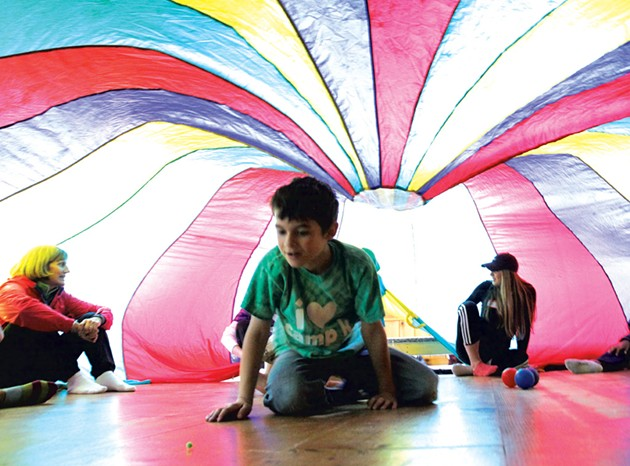 Parachute play at Camp Kaleidoscope - MATTHEW THORSEN