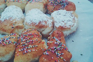 Fried dough with sprinkles and powdered sugar