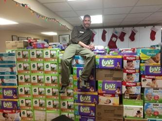 Jason Fitzgerald atop the diaper wall