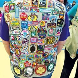 The vest of veteran Girl Scout Desiree Herring - ALISON NOVAK