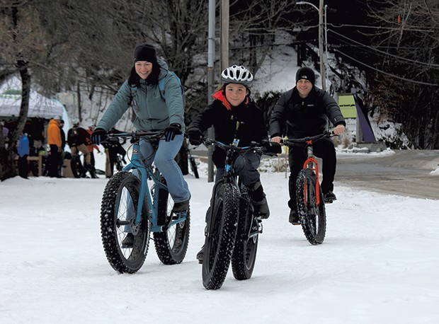 The Garbach family tries out fat bikes at the Überwintern festival in Stowe - TRISTAN VON DUNTZ