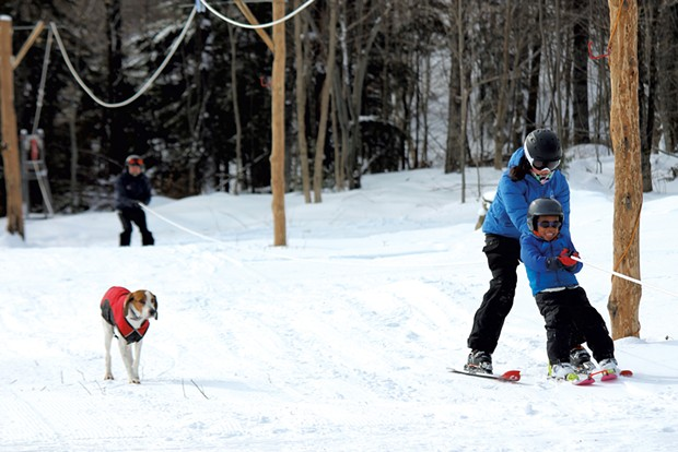 Family members ride the rope tow - TRISTAN VON DUNTZ