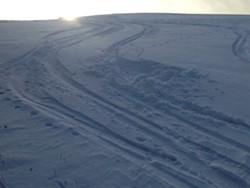 Making ski turns in the afternoon sunlight - SARAH GALBRAITH