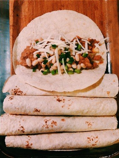 Preparing and rolling tortillas - ERINN SIMON
