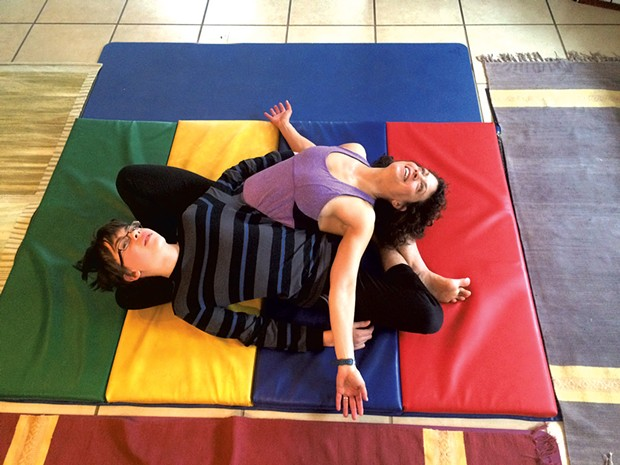 Janet and Adam practice the yin-yang stretch - COURTESY OF JANET FRANZ