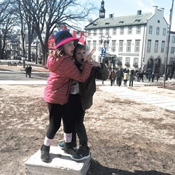 """A kid """"statue"""" outside the Frontenac"""