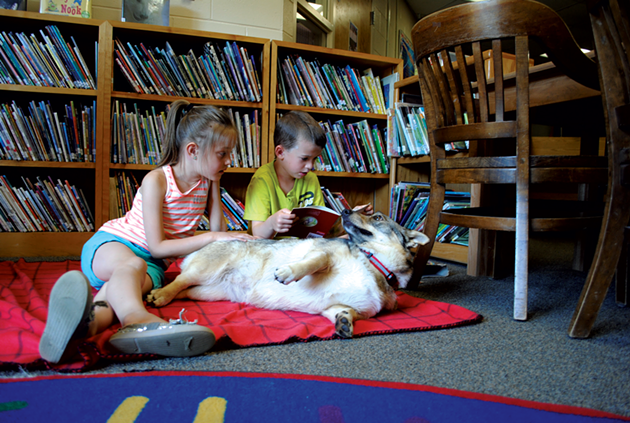 Luci and Jeffrey reading with Cora - DARCIE ABBENE