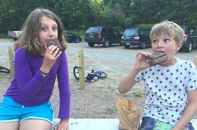 Mira and Theo enjoying ice-cream sandwiches - ALISON NOVAK