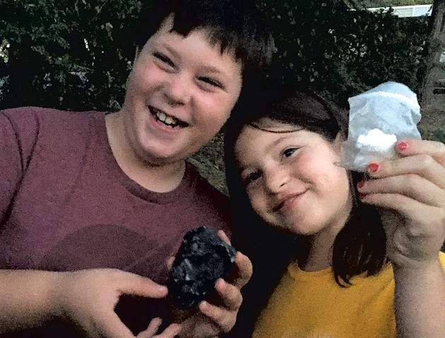 Graham and Ivy with the cache and paper log they found - CATHY RESMER