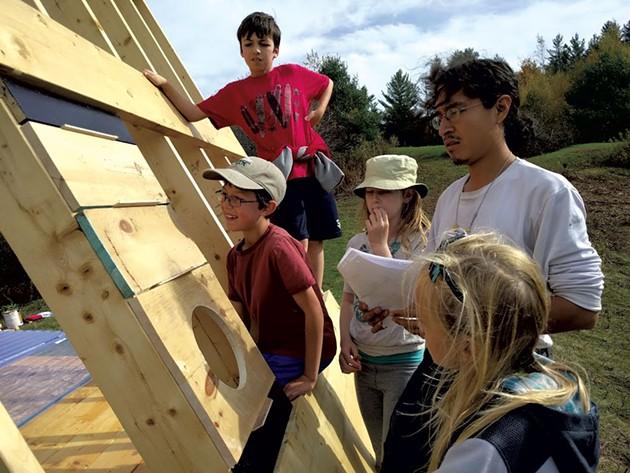 Eddie Merma with his building students - SARAH YAHM