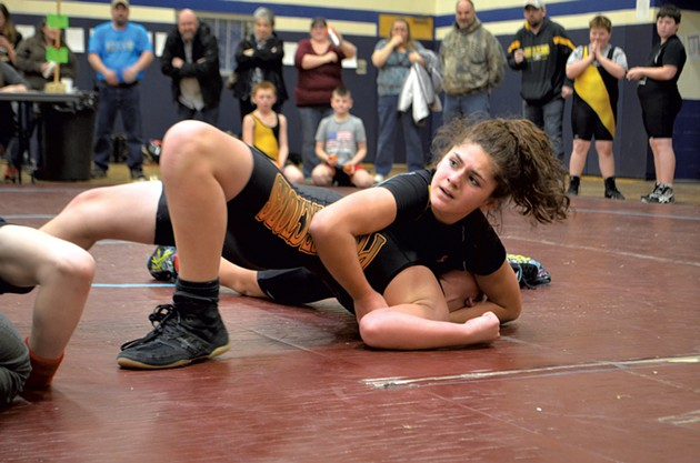 Lahna Descheneau of the Northeast Kingdom Pythons makes the winning move against an opponent from the St. Johnsbury Prospectors - CATHY RESMER