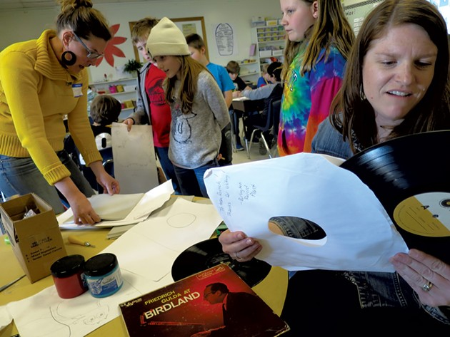 Carin Lilly (left) and Shannon Roesch (right) help students with block printing - MATTHEW THORSEN