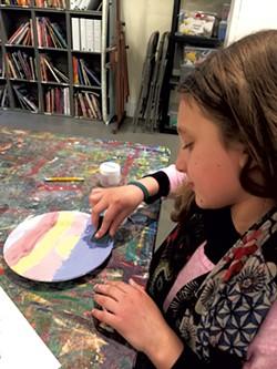 Mira finishes her sunset plate - ALISON NOVAK