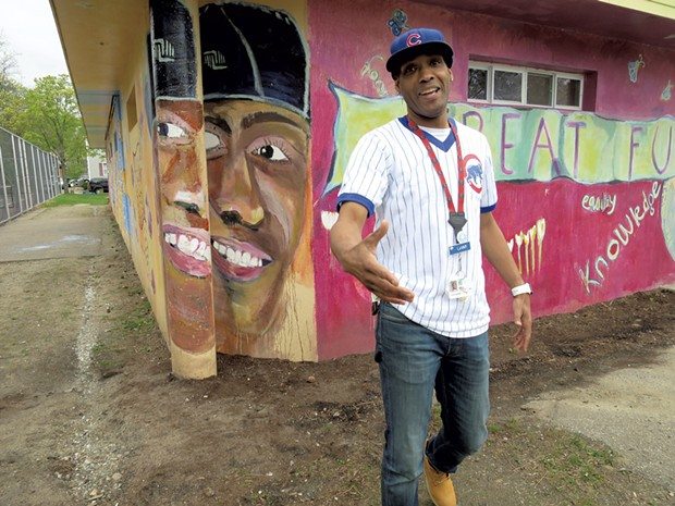 Barrino in front of his portrait on the mural in Roosevelt Park - MATTHEW THORSEN