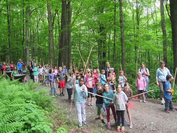 Second graders from Woodstock, Stockbridge and Killington Elementary Schools raking a trail at the Marsh-Billings-Rockefeller National Historical Park - J HALEY/NATIONAL PARK SERVICE