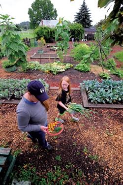 Rowan Moran, 8, and mom, Karen, harvest vegetables - JEB WALLACE BRODEUR