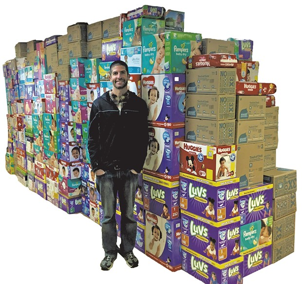 Fitzgerald in front of the wall of diapers - COURTESY OF DEE PHYSICAL THERAPY