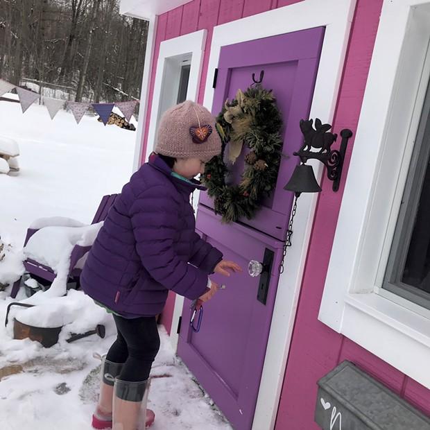 Nora pretends to lock the playhouse door - COURTESY OF JAMIE CUDNEY