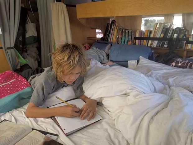 Nahum does schoolwork - COURTESY OF GRACE AHMED