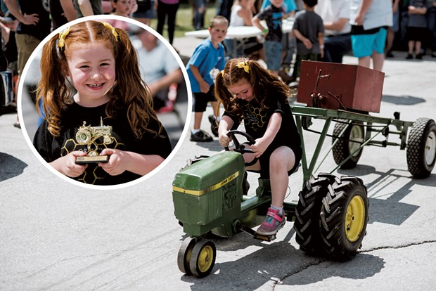 Aliana Talcott, 6, of Fairfield, gives it her all during the Pedal Pull. - SAM SIMON