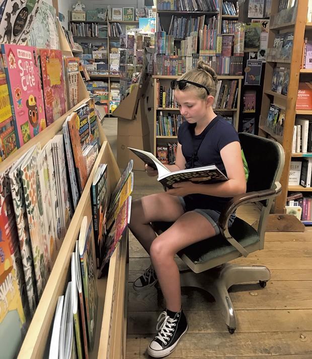Maverick browses at Everyone's Book - BRETT STANCIU
