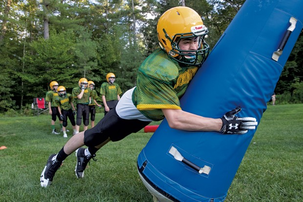 Eighth grader Jake Labell practices his tackling technique at a Colchester Catamounts preseason practice - JAMES BUCK