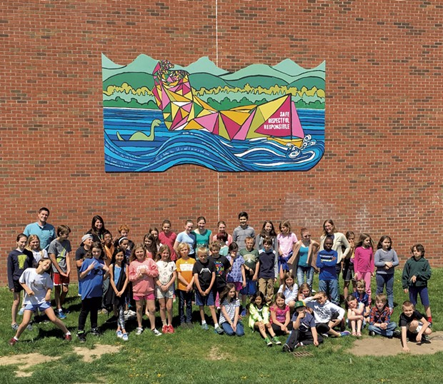 Shelburne Community School students in front of the playground mural they painted