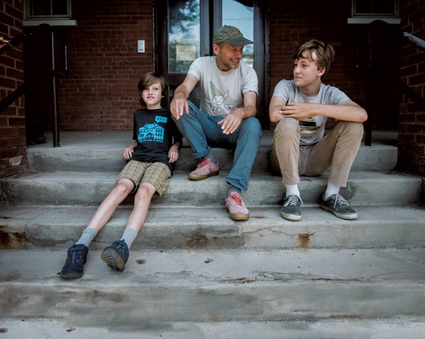 James Kochalka, 50, Vermont's first cartoonist laureate and author of the Johnny Boo series of graphic novels, with sons Oliver, 10, and Eli, 15 - SAM SIMON