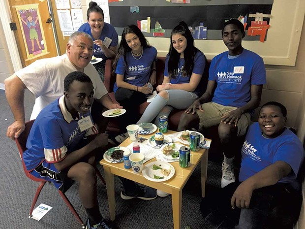 Teens at Sara Holbrook's drop-in center with middle school program director Gabriel Diaz - COURTESY OF SARA HOLBROOK COMMUNITY CENTER