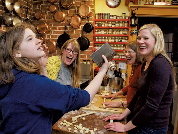 Astrid (second from left) makes gnocchi with her daughter, mom and sister - ANDY BRUMBAUGH