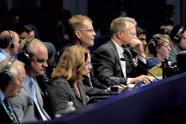 Dr. Bailly (center) pronouncing at last year's Scripps National Spelling Bee - COURTESY OF MARK BOWEN/SCRIPPS NATIONAL SPELLING BEE