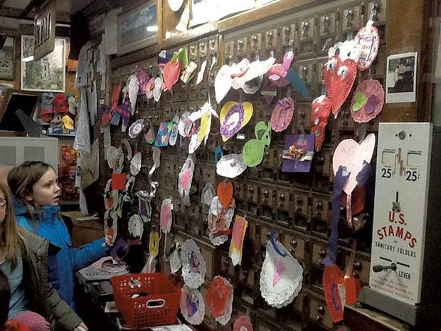 Izzy Wills and the post office boxes she and other students decorated for Valentine's Day - COURTESY OF THE ELMORE SCHOOL