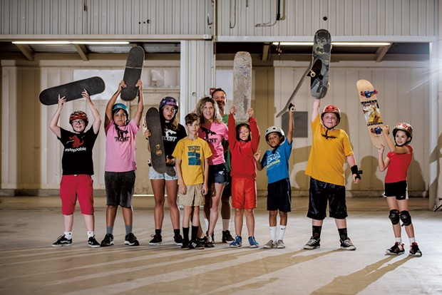 Hannah Deene Wood and David Wood with skateboarders (from left to right) Kyle Buck, Jasper Cleary, Juni Cleary, Henry Meunier, Arthur Lea, Creston Lea-Simons, Liam Kelley and Evelyn Santillo at Talent's new Burlington location - SAM SIMON