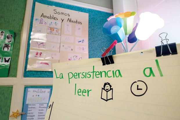 Signs in Spanish adorn Sylvan Ross' Spanish immersion kindergarten classroom at Jericho Elementary School - GLENN RUSSELL