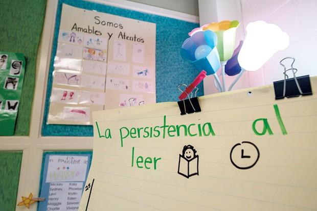 Signs in Spanish adorn Sylvan Ross' Spanish immersion kindergarten classroom at Jericho Elementary School - GLENN RUSSELL