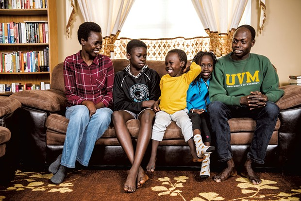 Akol Aguek (right), an international student advisor at the University of Vermont, and Martha Machar (left), deputy finance officer for the city of South Burlington, with kids Deng, 13, Ngong, 4, and Adut, 6 - SAM SIMON