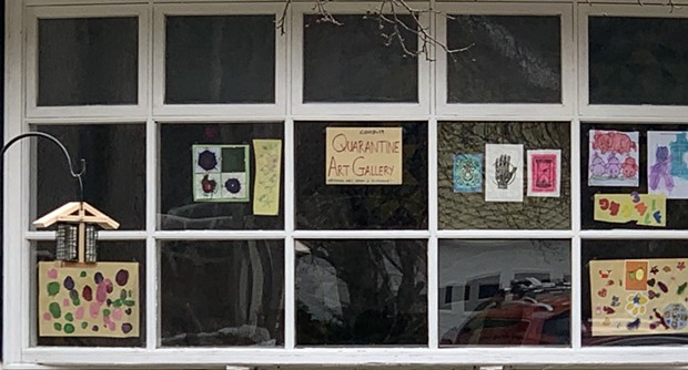 """Coronavirus won't stop kids' learning and creativity. A """"quarantine art gallery"""" displayed in a family's front window in Shelburne. - ALISON NOVAK"""