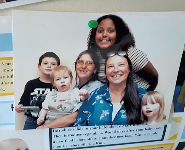 Diane Deso (front, second from right) with grandchildren Kyle, Jamie and Autumn, and Family Room staff member Rosie Senna (with an unrelated child) - COURTESY OF DIANE DESO
