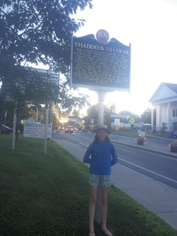 Somerset Pierce in front of the historical marker commemorating the birthplace of abolitionist Thaddeus Stevens