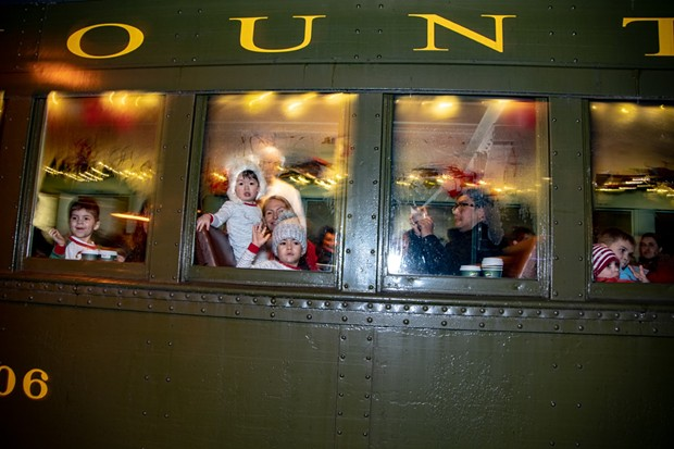 Children look out the train window during the Polar Express in 2018 - COURTESY OF VERMONT CHILDREN'S TRUST FOUNDATION