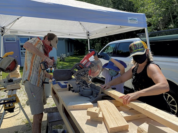 Volunteers cutting wood for convertible desk-benches - COURTESY OF LAKE CHAMPLAIN WALDORF SCHOOL