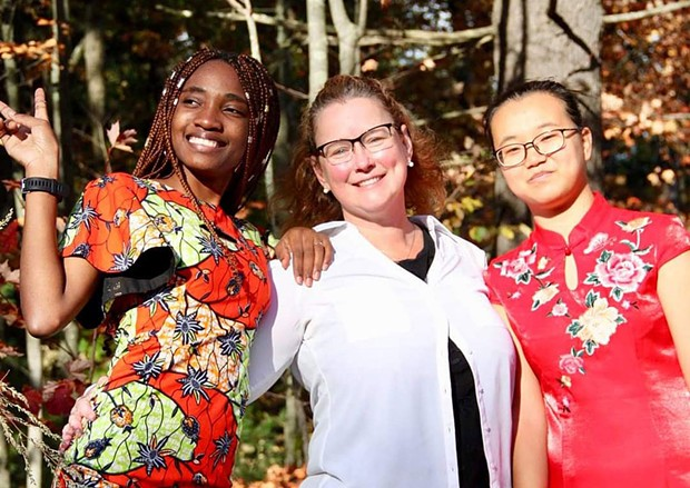 Teacher of the year Susan Rosato with students Steldie Mabiala (left) and Peas Liu - COURTESY OF MEGAN MCLOUGHLIN