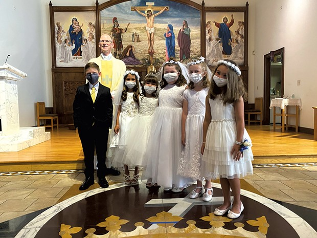 Cameron (left) during his first communion - COURTESY OF KATIE NUNN