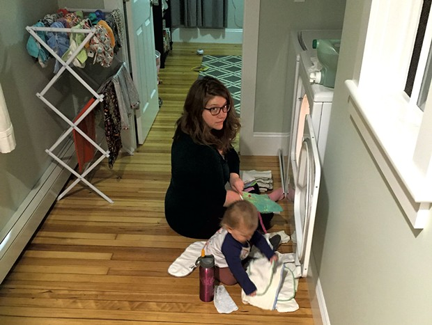 Meredith folding laundry with her daughter - COURTESY OF MEREDITH BAY-TYACK