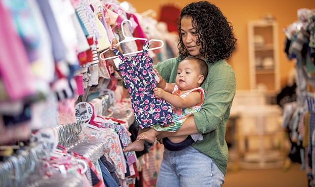 Maria Munroe and her 9-month-old daughter, Malia, shopping at Boho Baby - CAT CUTILLO