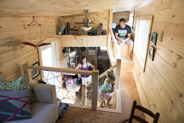 Living small a family of three makes a tiny house their for Large family living in small house