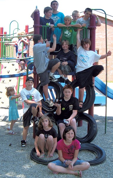 Campers pose on a play structure - COURTESY OF OCCC