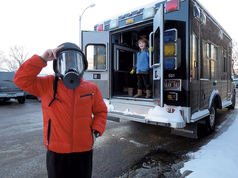 """I'm ready for the zombie invasion!"" announced Rob Safran, trying on a police gas mask outside the Burlington Police Department's tactical platform vehicle. - MATTHEW THORSEN"